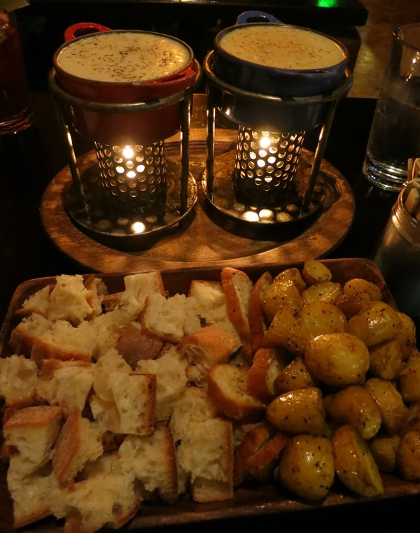 fondue and carbs (seasoned red potatoes, bread)