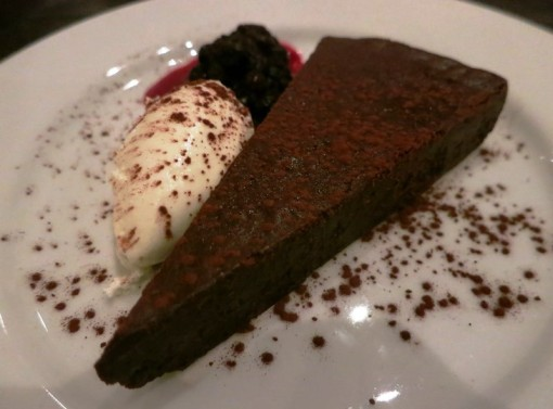 flourless Valrhona chocolate & bourbon cake, huckleberry, whipped cream $7